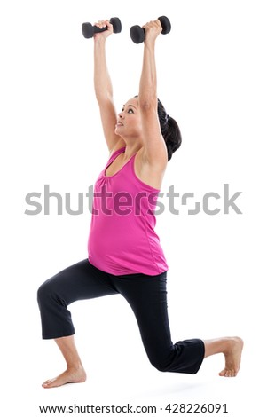 Mixed race Hispanic woman 7 months pregnant doing lunge to shoulder press exercise with light weights isolated on white - stock photo