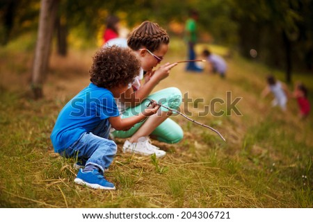 Mixed race kids are playing outside - stock photo
