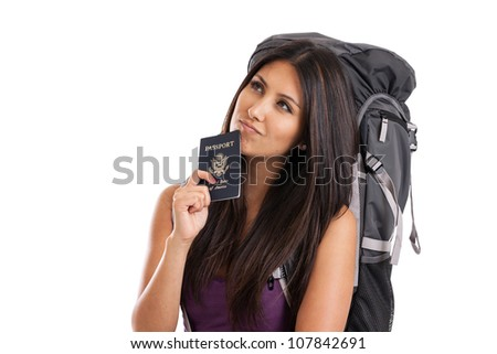 Mixed race traveler with backpack and US passport isolated on white - stock photo
