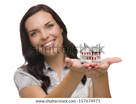 Mixed Race Woman Holding Small House Isolated on White Background - Focus is On The House. - stock photo