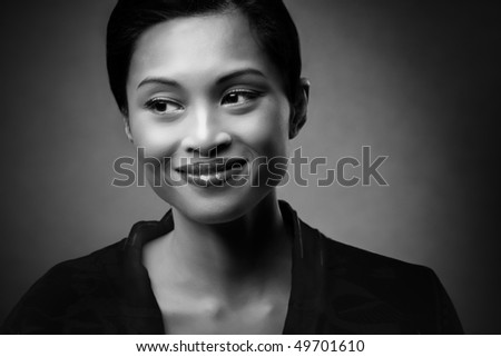 Mixed race woman smiling on studio background