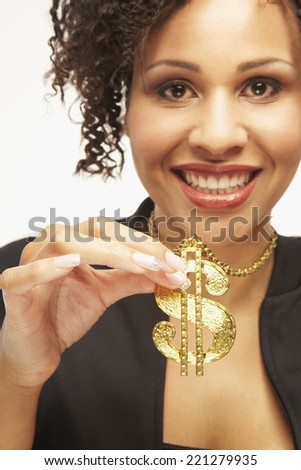 Mixed Race woman wearing dollar sign necklace - stock photo