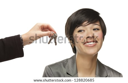 Mixed Race Young Woman Being Handed Keys Isolated on a White Background. - stock photo