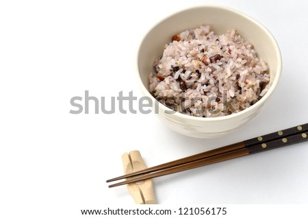 Mixed rice in japanese rice bowl (with Chopsticks and chopstick rest). - stock photo