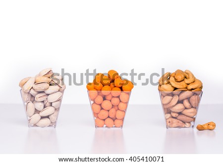 Mixed Roasted nuts, pistachios and cashews on white background. - stock photo