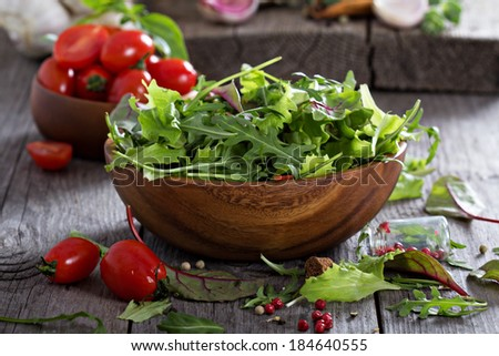 Mixed salad green leaves in a wooden bowl - stock photo