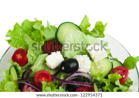Mixed salad in a glass bowl close up. White isolated - stock photo