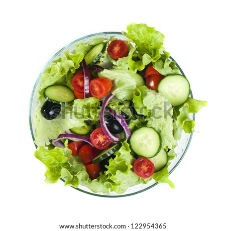 Mixed salad in a glass bowl on a white background - stock photo