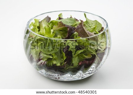 Mixed salad leaves in a glass bowl - stock photo