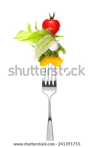 Mixed salad on fork isolated on white - stock photo