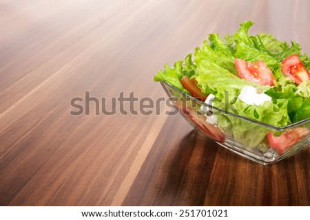 Mixed salad or vegetables, studio shot with copyspace for text - stock photo
