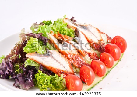 Mixed salad with eel and cherry tomatoes