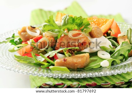 Mixed salad with pieces of pan roasted chicken - stock photo