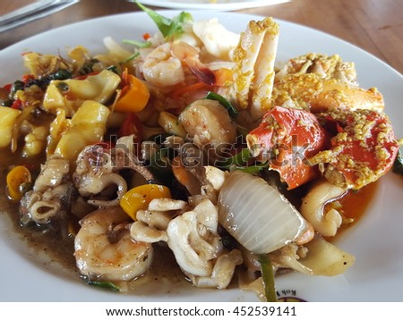 Mixed seafood dish from Captain Hook resort, Kood island, Trat, Thailand. - stock photo