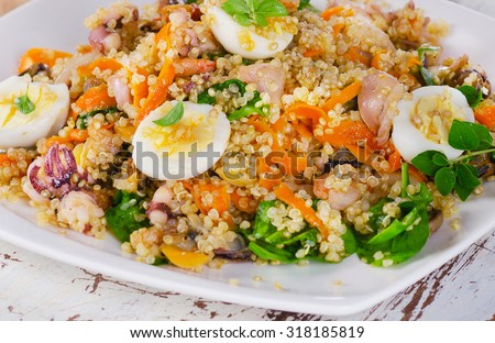 Mixed seafood salad with quinoa. Selective focus