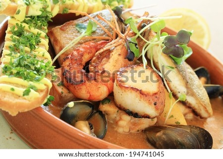 mixed seafood starter in dish - stock photo