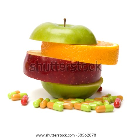 mixed sliced fruits and pills isolated on white background - stock photo
