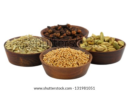 Mixed spices in small wooden bowls isolated on white - stock photo