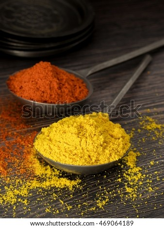 Mixed spices on a dark wooden background