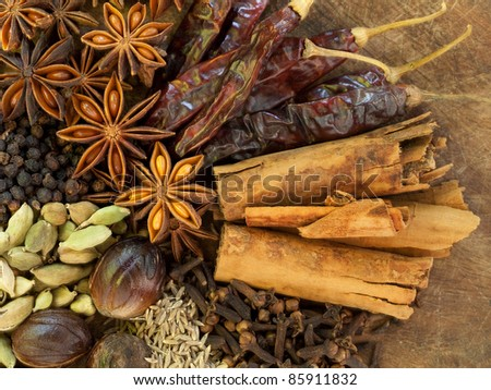 Mixed Spices on a Wood Background - stock photo