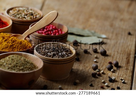 Mixed spices on wooden table set - stock photo