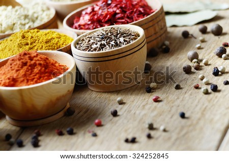 Mixed spices on wooden table set