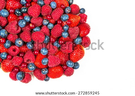 Mixed summer berries isolated on white background - stock photo