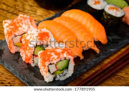 Mixed sushi plate with california rolls nigiri and maki stock photo
