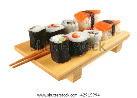 mixed sushi plate with sticks on white background - stock photo