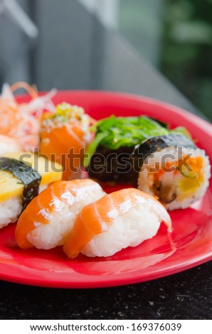 Mixed sushi set on a red plate , favorite japanese food