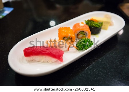Mixed sushi set on a white plate