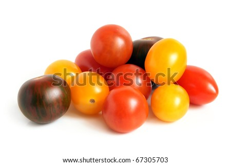 Mixed tomatoes on a white background - stock photo