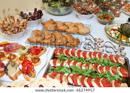 Mixed up tapas and cold buffet - stock photo