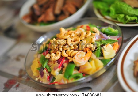 Mixed vegetable dish topped with cashew nuts