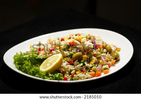 mixed vegetable rice salad with lemon - stock photo