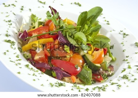 Mixed vegetable Salad w spinach - stock photo