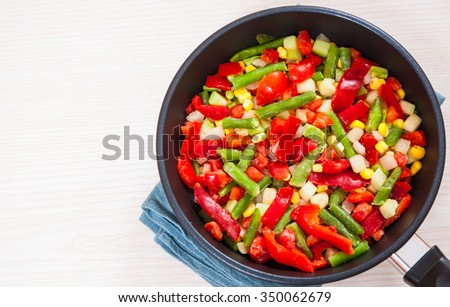 Mixed vegetables in a frying pan - stock photo