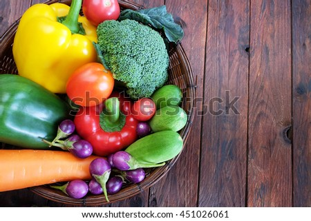 mixed  vegetables  in  basket on wooden table - stock photo