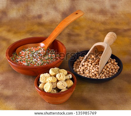 Mixed vegetables in bowl with wooden spoon - stock photo