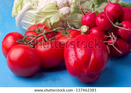 Mixed vegetables on a blue background - stock photo
