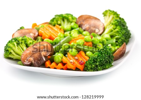 Mixed vegetables on a plate isolated on white background - stock photo