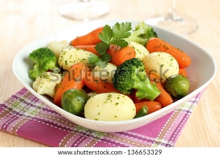 mixed vegetables sauteed butter and spices on table - stock photo