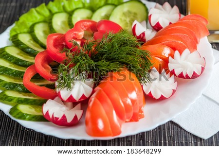 Mixed vegetables. tomatoes, cucumbers, peppers and radishes - stock photo