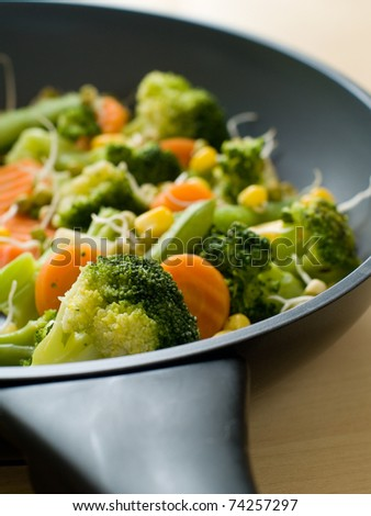 mixed  vegetables with fresh sprout in pan.  Selective focus