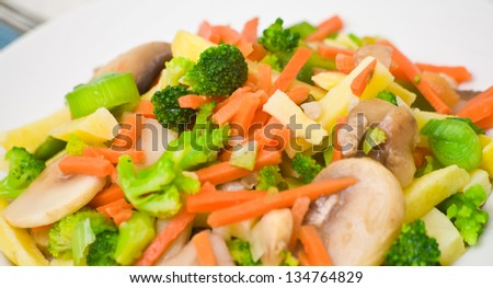 Mixed vegetables with mushrooms on a plate