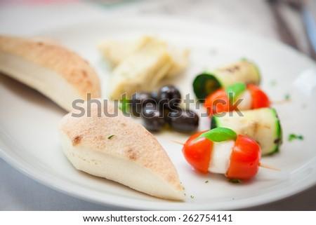 Mixed vegetarian antipasto in an italian restaurant - stock photo