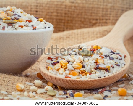 Mixed Whole grain Traditional Thai rice best rice for healthy and clean food on hemp sacks background - stock photo
