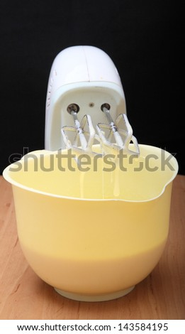 mixer and a yellow plate - stock photo
