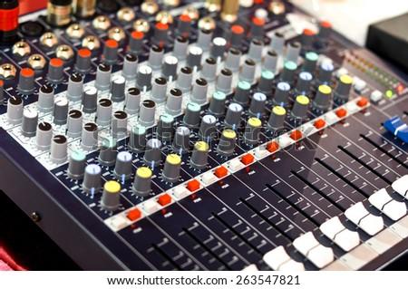 mixer buttons equipment in audio recording studio - stock photo