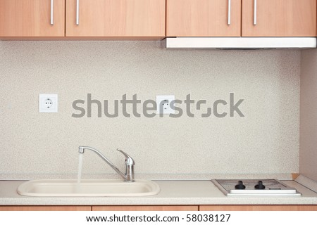 Mixer Faucet /tap  with running water  in a kitchen - stock photo